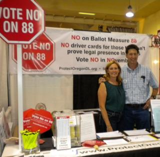 Candidate Greg Barreto and wife Chris volunteer in the booth