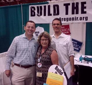 Daniel Crowe, candidate for Attorney General and OFIR VP Rick LaMountain help out ini the OFIR booth.