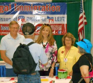State Senator Kim thatcher, Arnold Toller and OFIR Prsident Cynthia Kendoll chat with fair visitors