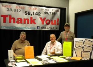 Volunteers in the booth at the Dorchester Conference