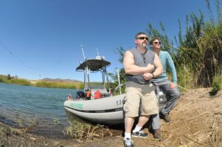 Steven Camarota - and John Wahala, both with CIS pose near a Border Patrol boat.